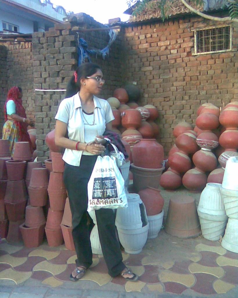 Rina purchasing an earthen pot...