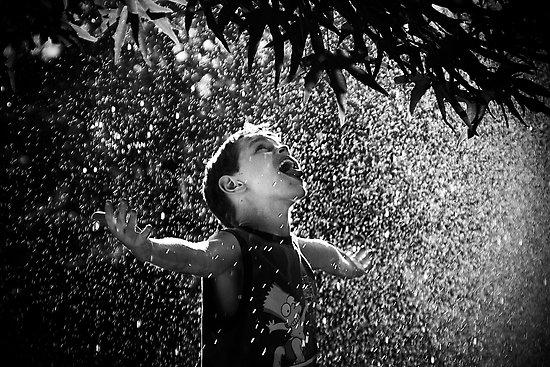 boy-playing-in-rain